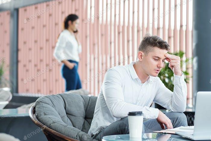 Pensive businessman reading document