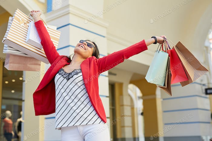 Happy lady with purchases