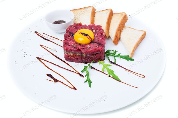 Delicious steak tartare with egg yolk.