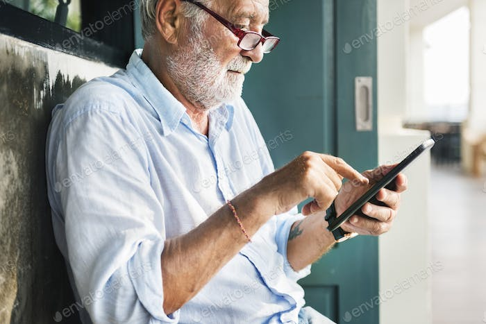 Old Man Using Telephonne Online Concept