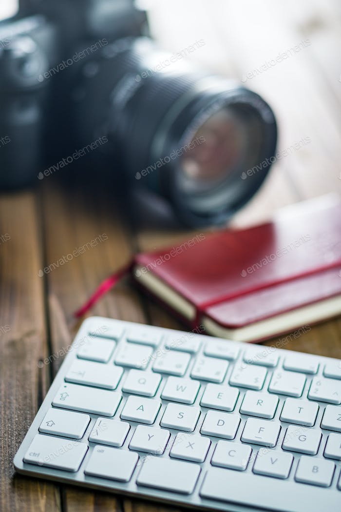 Professional digital camera and computer keyboard.