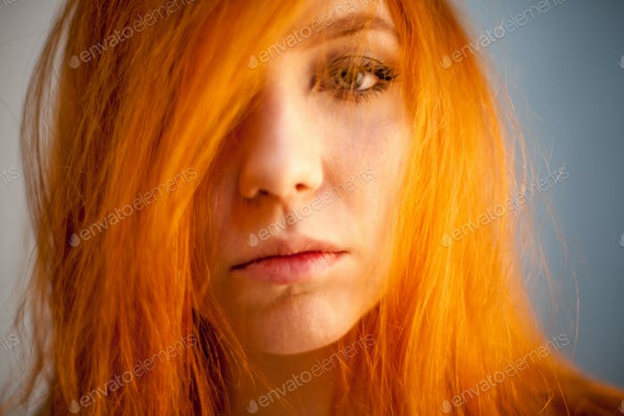 Thumbnail for Portrait of redhead woman in soft focus