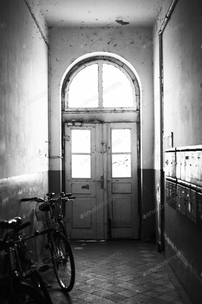 Bicycle parked in an old hallway