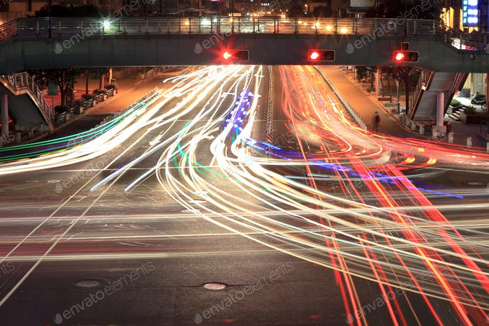 light traces on crossroad at night