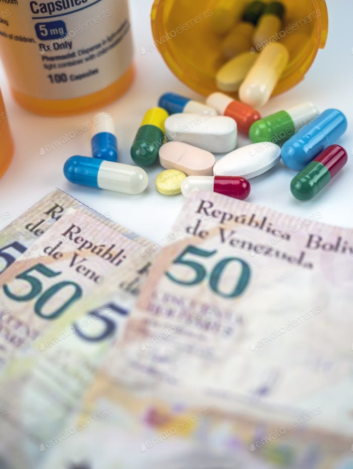Medicines next to banknotes of Venezuela
