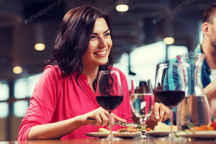 happy woman having dinner at restaurant