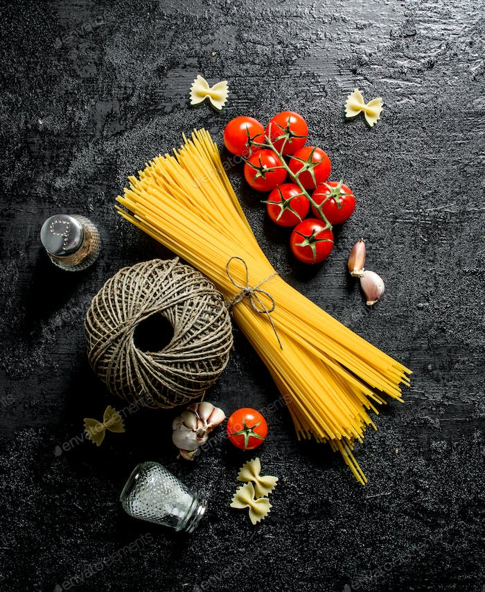 Raw spaghetti with tomatoes, spices and old thread.