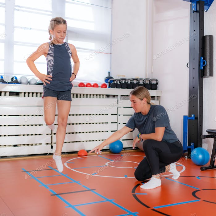 Coordination and agility exercise for children, skipping through agility ladder