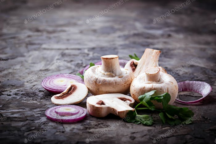 Fresh champignon mushrooms and red onion