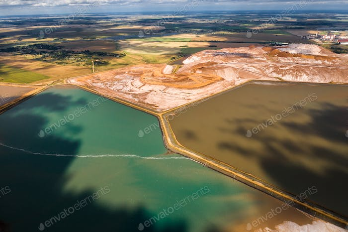 Mountains of products for the production of potash salt and artificial turquoise reservoirs.Salt