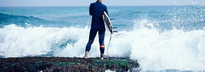 Surfer on seaside
