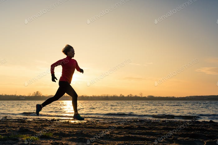 Woman beach running silhouette sunrise, lake coastline