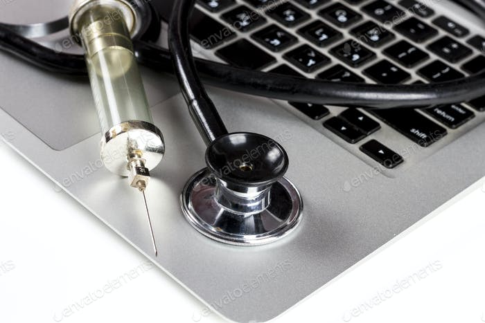 Stethoscope and Syringe on Keyboard