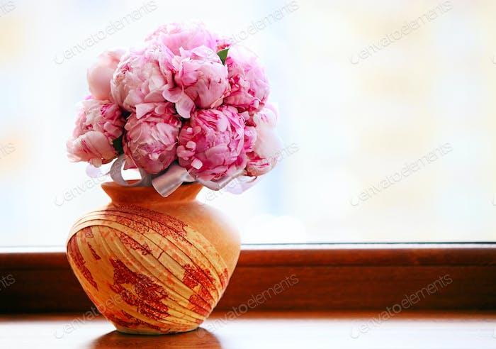 Peonies bouquet in a vase