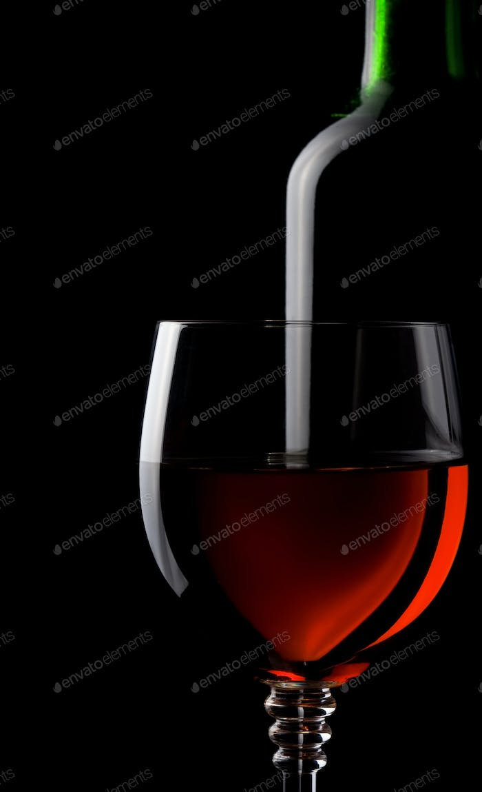 wine in glass and bottle isolated on black