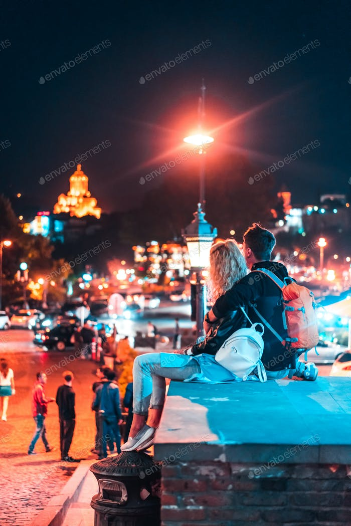 Couple in the background of the Tbilisi.