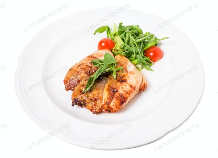 Grilled chicken fillet with tomatoes cherry.