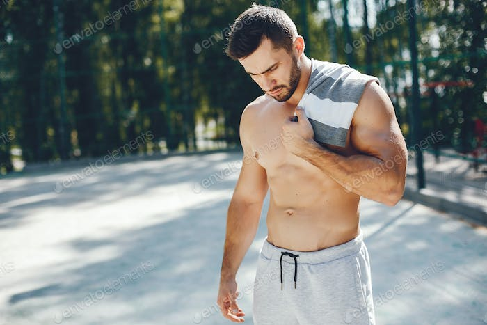 Sports man in a morning summer park