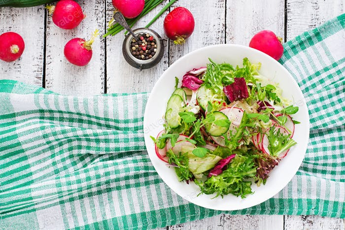 Fresh salad of cucumbers, radishes and herbs. Top view