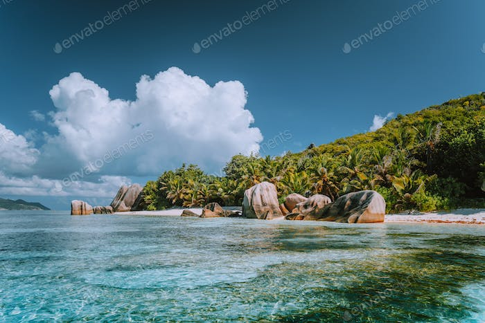 Anse Source d'Argent - Cloudscape over paradise beach with bizarre rocks and shallow lagoon