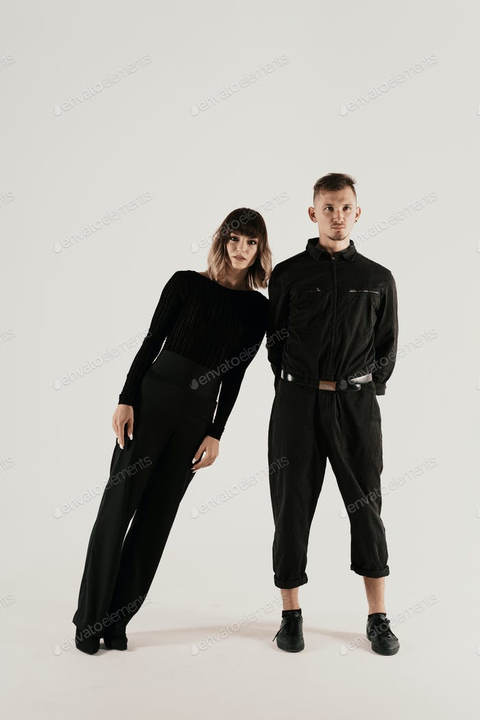 Millennial fashion couple on a white background in studio