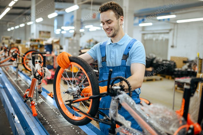 Bicycle factory, assembly line, wheel installation