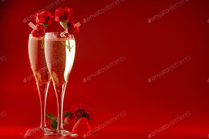 Valentines day red background with champagne glasses