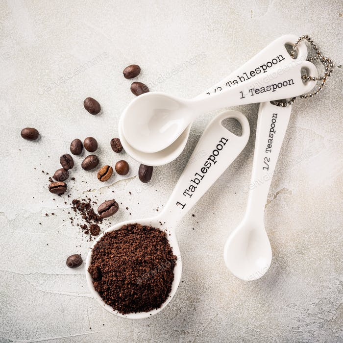 Measuring spoons with ground coffee