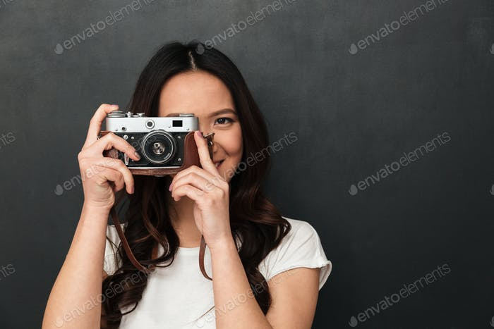 Asian young happy woman photographer