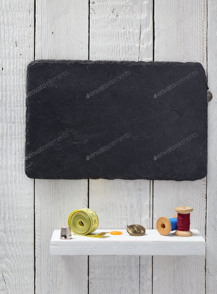 sewing tools and accessories on wooden shelf
