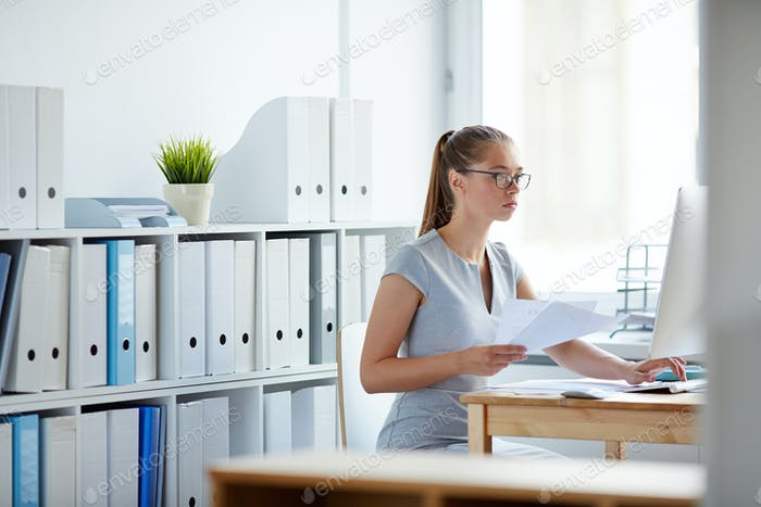 Young Woman Concentrated on Work