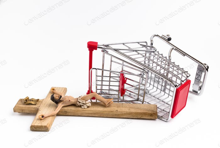 Shopping cart overturned with crucifix on the ground