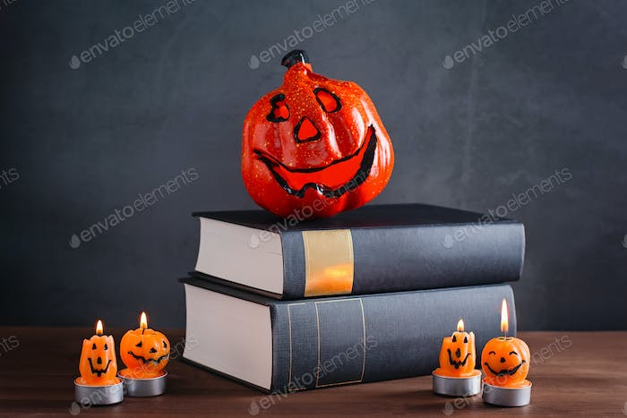 Book shelf with stack of books. Halloween reading concept