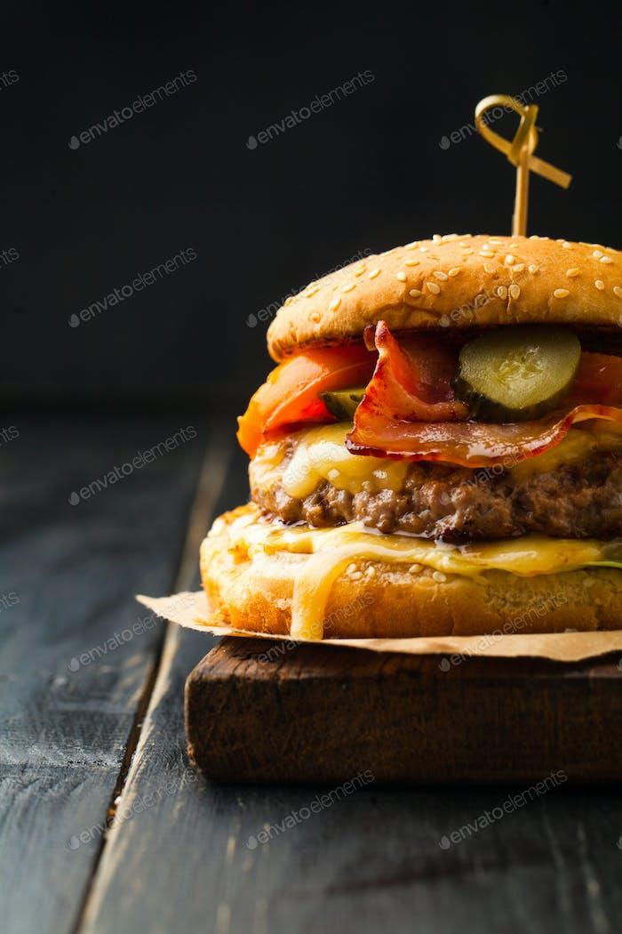 Delicious burger with meat and bacon