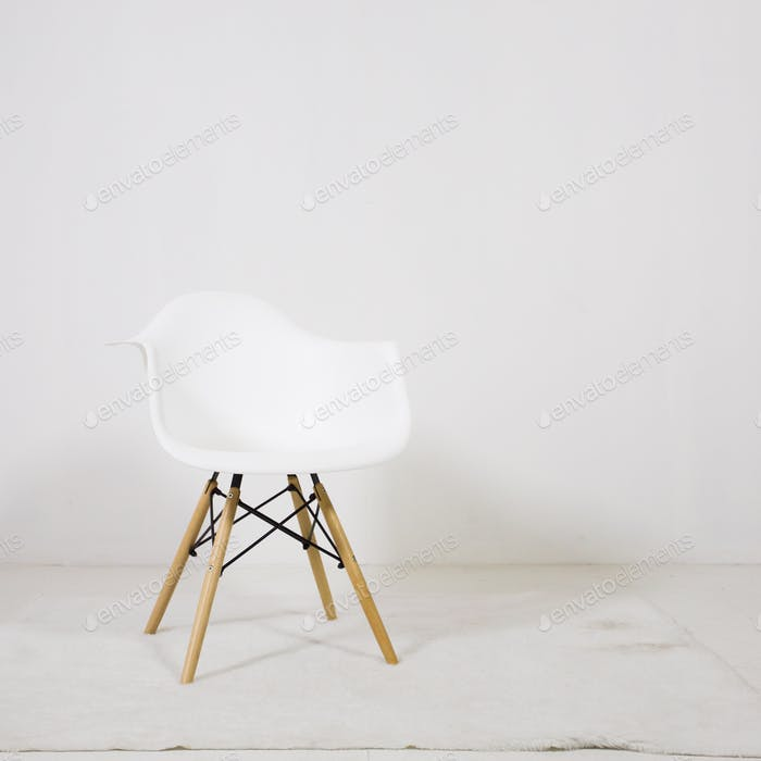 White Wooden Leg Chairs with white wall and white wooden floor
