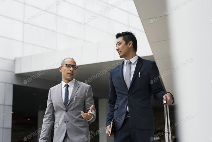 Businessmen discussing on the go