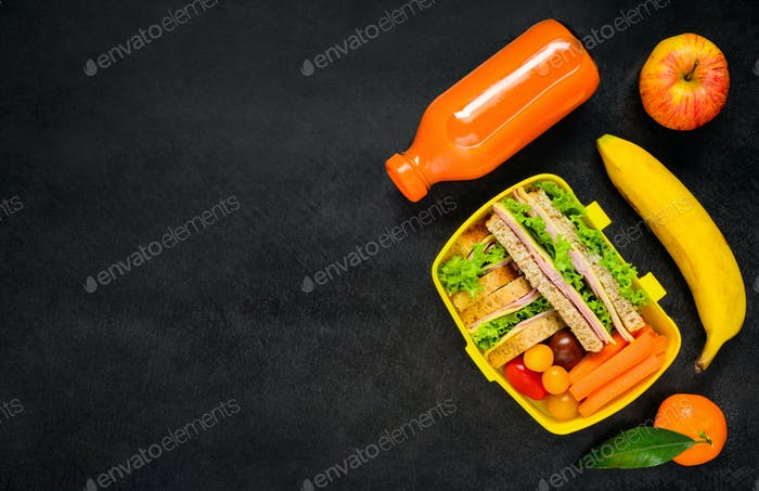 Yellow Lunch Box with Food on Copy Space