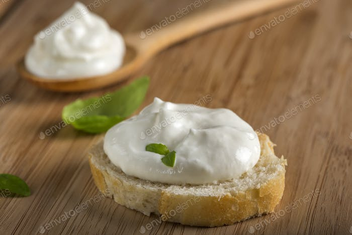 Cream-cheese and basil on french bread