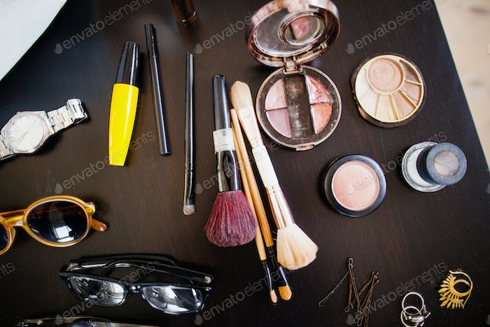 High angle view of various beauty products on table in studio