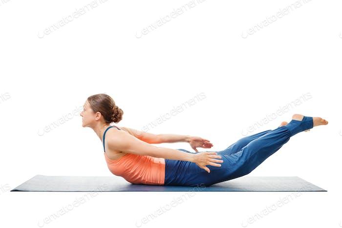Woman doing Ashtanga Vinyasa Yoga asana Salabhasana