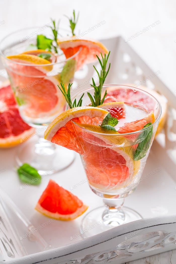 Refreshing infused water with pink grapefruit, cantaloupe melon and mint
