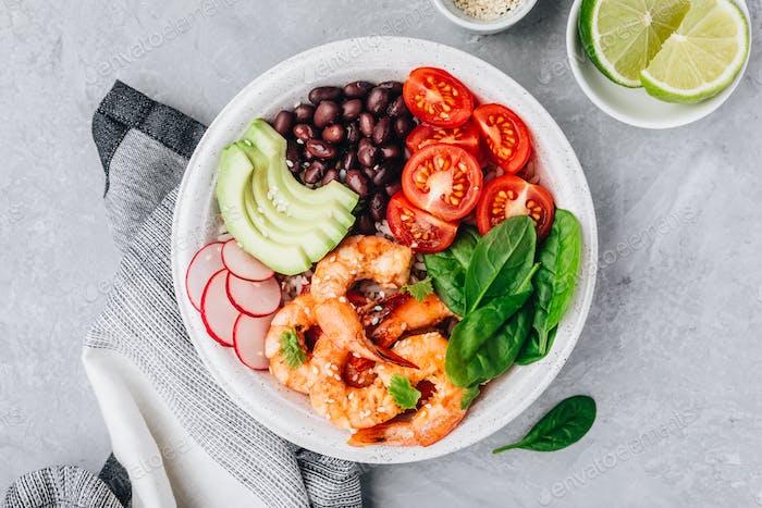 Spicy Shrimp Burrito Buddha Bowl with wild rice, spinach, radish,  tomatoes, black beans and avocado