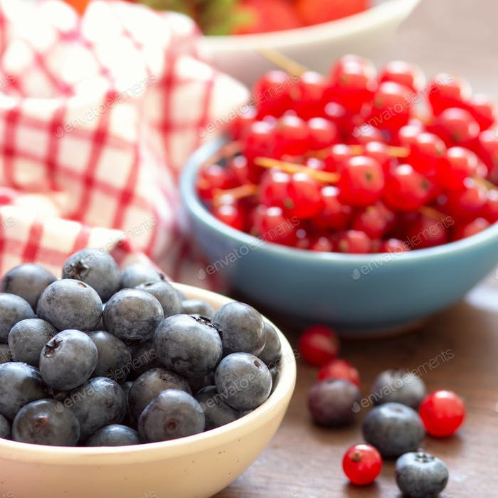 Fresh berries - blueberries, red currants and strawberries