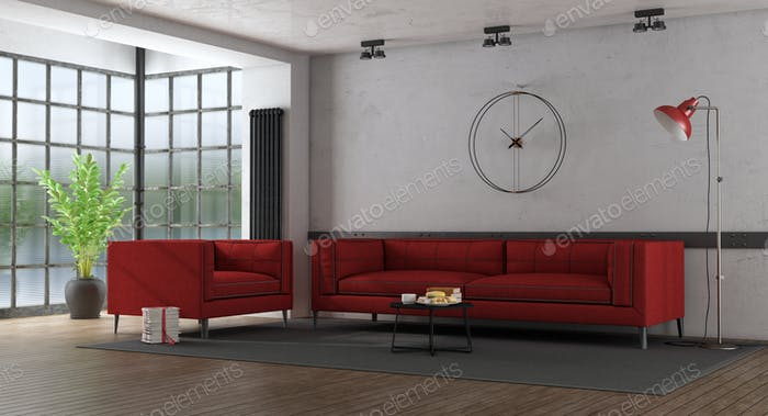 Red fabric sofa and armchair in a loft