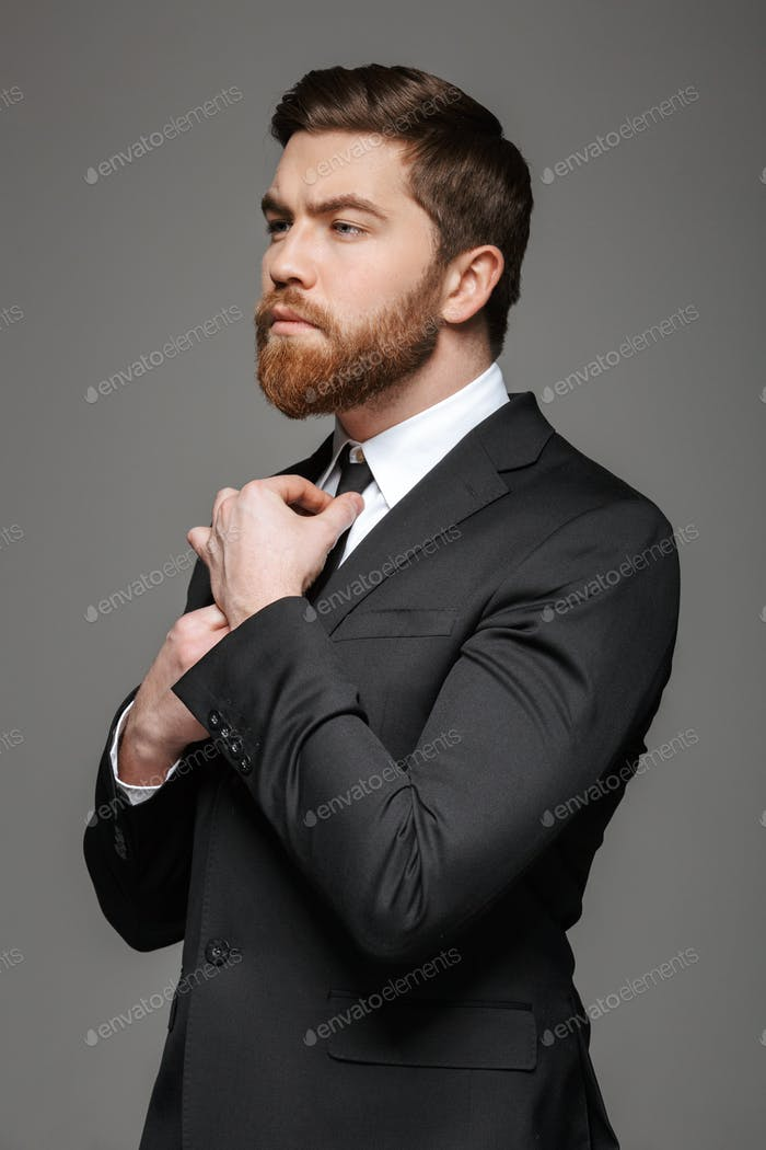 Portrait of a handsome young businessman dressed in suit