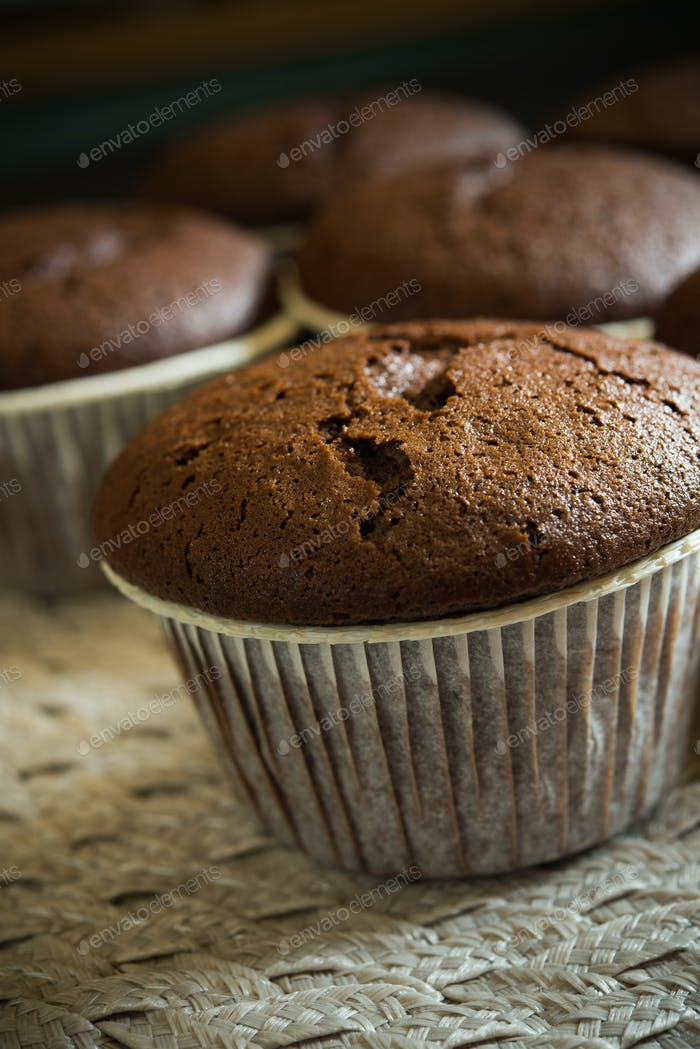 Chocolate muffin on black background
