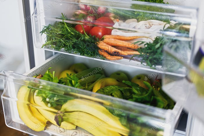 Zero waste grocery in fridge. Fresh vegetables in opened drawer in refrigerator