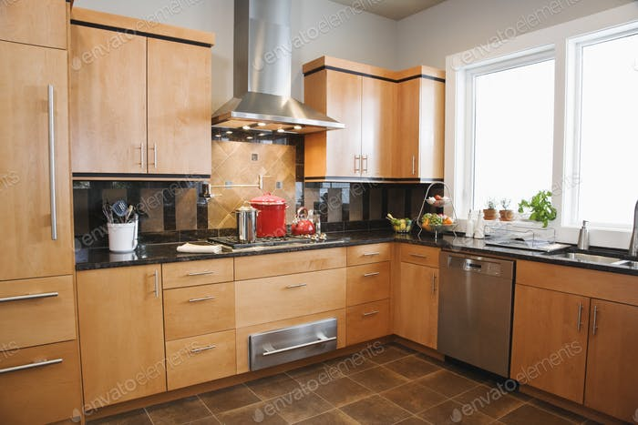 A fitted kitchen interior in a home.