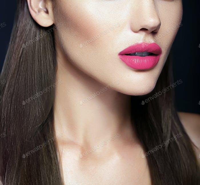 Closeup beauty portrait of young woman posing in studio