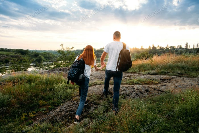 Local travel, Solo Explorers, Small Group tourist. Young couple going for hiking, walk in nature